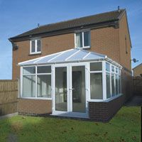 White conservatory with white doors